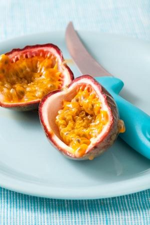 Delicious fresh passion fruit halves. Studio shot. photo