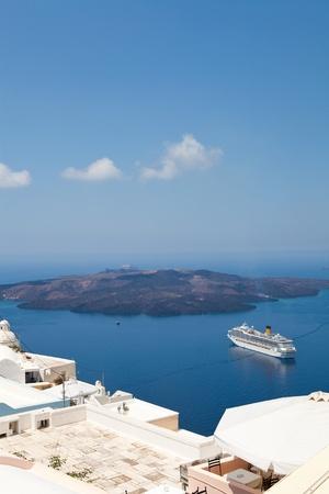 Cruise ship in Thira, Santorini island, Greece photo