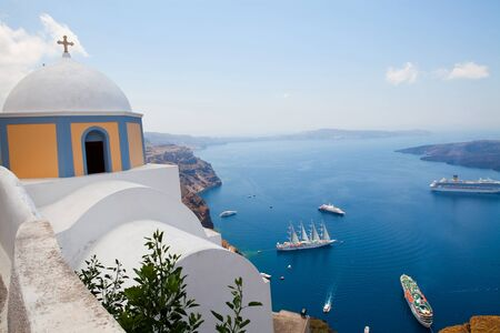thira: Old church dome and view of boats in Thira, Santorini Stock Photo