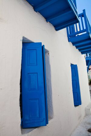 White building with blue windows in Mykonos, Greece photo