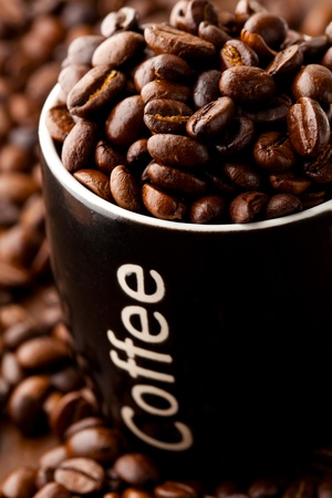 Close-up of coffee beans and a coffee mug