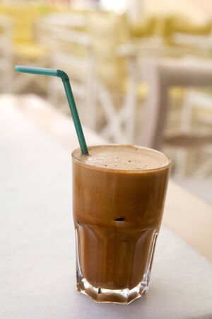 Frappe on a cafe table in Naxos, Greece photo