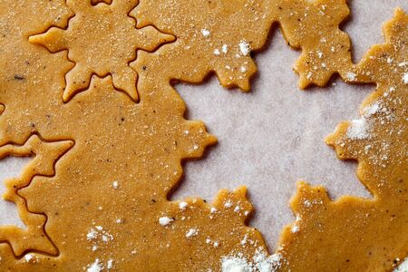 Making gingerbread cookies for Christmas. Gingerbread dough with star shapes. photo