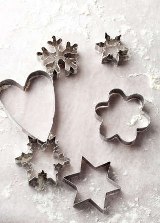 Background with metallic gingerbread cutters for Christmas photo