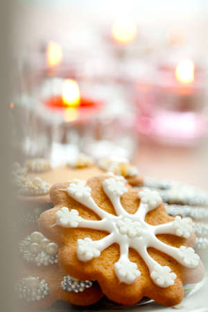 Close-up of delicious decorated Christmas gingerbread cookies with candles photo