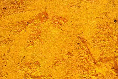 yellow stone: Piedra amarilla brillante textura de la pared de fondo de Assos, Cefalonia, Grecia