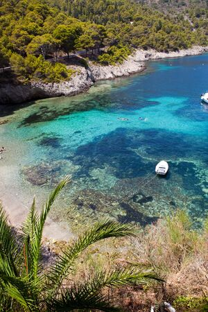 Beautiful beach with turquoise water in Assos, Kefalonia, Greece photo