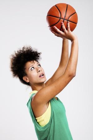 Beautiful athletic woman with basketball. Studio shot. Stock Photo - 12274757