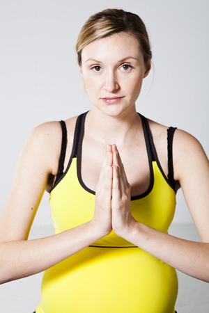 Pregnant woman meditating with hands together Stock Photo - 12883655