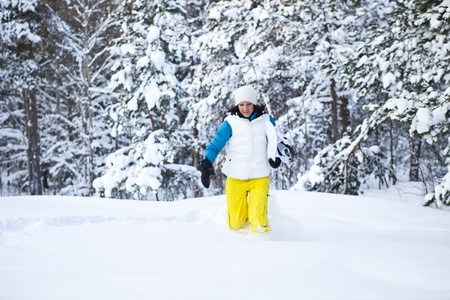 Female snowboarder running in snow with snowboard in beautiful cold winter weather Stock Photo - 13277444