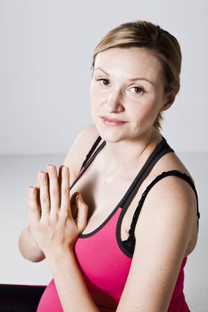 Pregnant woman meditating with hands together. Studio shot Stock Photo - 13314201