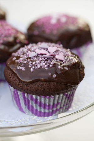 Close-up of delicious chocolate cupcakes with chocolate icing and sprinkles