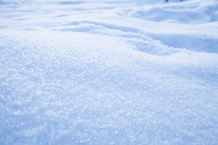 snow background: Fresh white powder snow background from outdoors on winter day Stock Photo