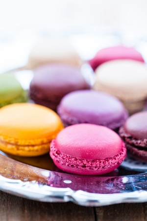 Closeup of macaroons on decorative silver tray