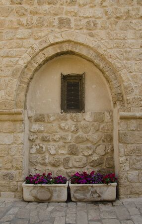jewish home: Ancient wall with window in Jaffa Israel Stock Photo