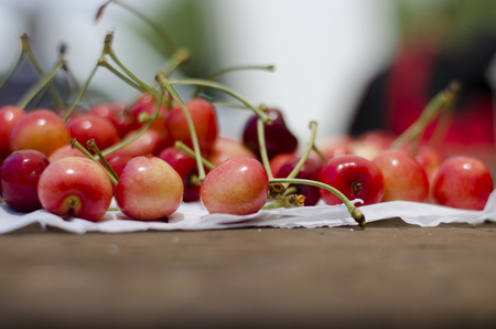 Red sweet cherries on the table. Cherry orchard