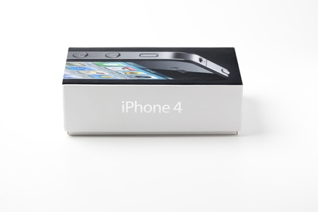 Box of a iPhone 4 isolated on white background  iPhone is a smart cellular phone produced by Apple Computer Inc  Stock Photo - 15004622