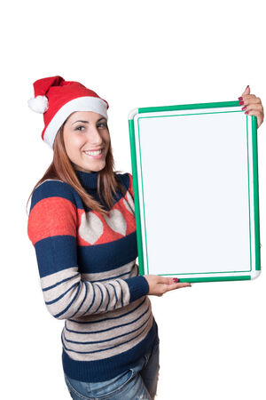 an young woman, smiling,  with christmas hat hold a whiteboard.