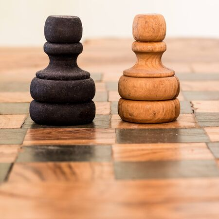 clash: two pawns wooden clash