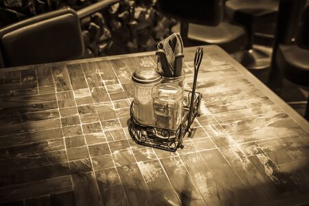 prepared table in an old pub. ancient ambience with sepia color.