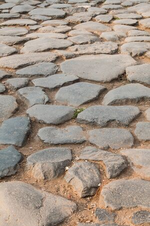 Detail of the ancient Roman road near the Coliseum, large boulders create the smooth road surface.
