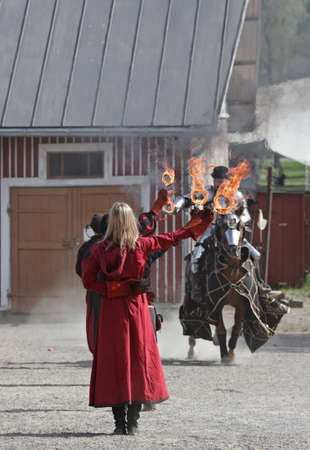 Hameenlinna, Finland, 05/20/2018: Medieval fair near ancient Hame castle with different entertainers like jugglers.