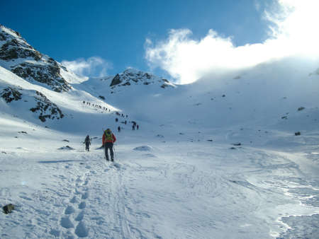 Winter mountaineers walking to the summit in the Apennines
