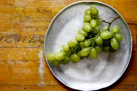 species of creeper: Picture about a bunch of grapes