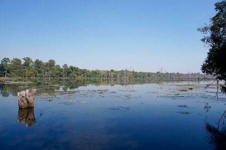 Blue reflections on the water, Neak Pean, Cambodia Stock Photo