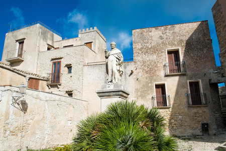 erice: Square in Erice with statue, Sicily, Italy Stock Photo