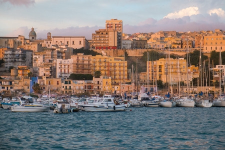 View of Sciacca town and harbour at sunset, Sicily, Italy