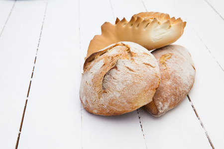 life loaf: Loafs of bread on a white wood table Stock Photo