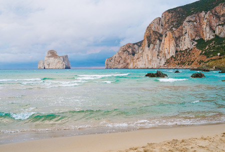 Masua beach with bad weather in the evening, Sardinia, Italy