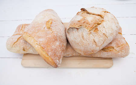 life loaf: Loaf of bread with different shapes on a cutting board