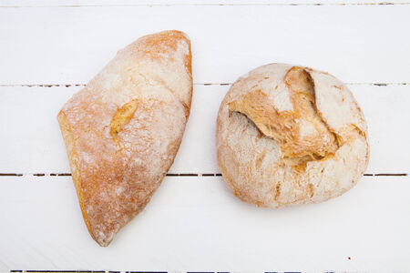 life loaf: Two loafs of bread on a white wood table