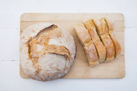 life loaf: Bread loaf and slices on a cutting board