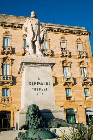 garibaldi: Garibaldi statue and old building in Trapani, Sicily, Italy Editorial