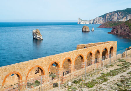 Laveria Lamarmora, an old mine building along the coast of Nebida and Masua, west coast of Sardinia, Italy Stock Photo