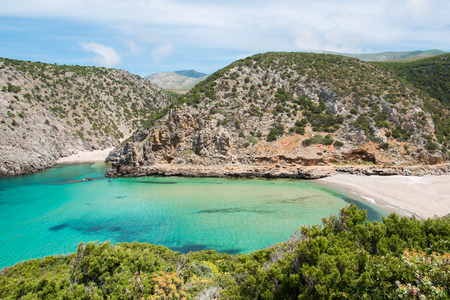 Cala Domestica beach and promontory, isolated and wild beach along the west coast of Sardinia, Buggerru, Italy