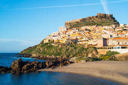 pictoresque: View of Castelsardo fortress and village from the beach at sunset, Sardinia, Italy