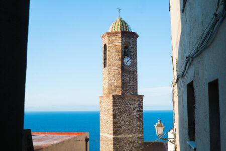 bell tower: Sant Antonio abate church bell tower in Castelsardo, Sardinia, Italy Stock Photo
