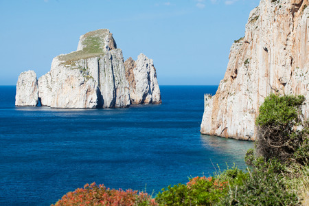 west  coast: Pan di zucchero rock island and Porto Flavia in Masua, west coast of Sardinia, Italy Stock Photo