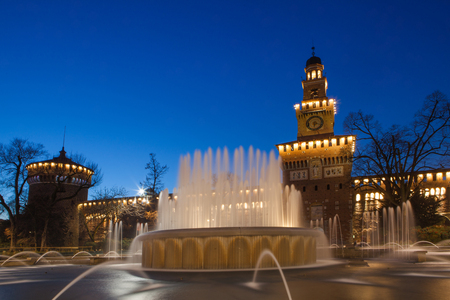 Sforzesco Castle by night in Milan, Italy