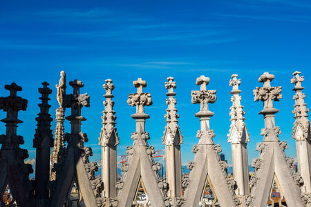 steeples: Detail of dome steeples on dome roof top in Milan