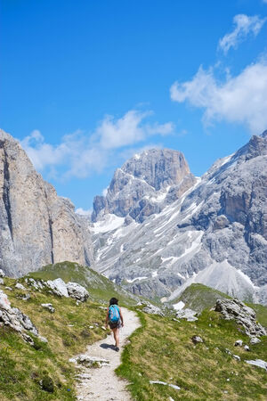 fassa: Girl hiking in Val di Fassa in Dolomites, Italy Stock Photo
