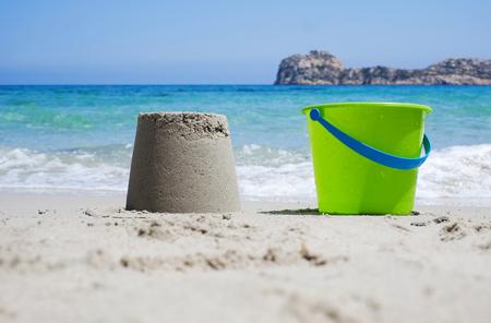 sandcastle: Bucket and sandcastle on a sandy beach Stock Photo