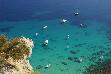 sella: Boats close to Sella del Diavolo,  Cagliari, Sardinia, Italy Stock Photo
