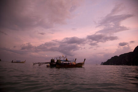 phi phi: Tropical sunset on the sea in Koh Phi Phi island, Thailand Stock Photo
