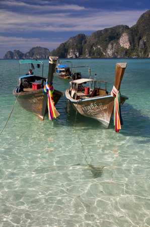 phi phi: Typical boats in Koh Phi Phi island, Thailand Editorial