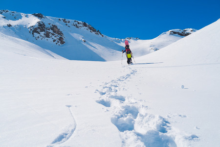 alpinist: Snowboarder alpinist on the Alps mountains close to Lac du Lou, Val Thorens, France Stock Photo